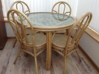 Cane circular glass topped table and 4 chairs