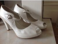 Spanish-made, once-worn size 6 (39) ivory. extremely comfortable for all day wear