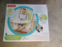 Fisher price travel high/chair booster seat. Brand new
