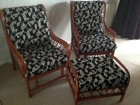 2 Conservatory wicker chairs and a footstool with black/cream cushions