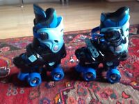 Adjustable roller skates, have never been used accompanied with pads for knees, elbows and wrists