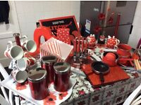 Everything red for a kitchen including Microwave, toaster, kettle & breadbin.