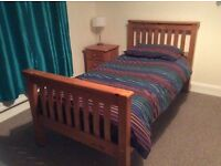 Single pine bed with mattress and bed side locker