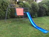Climbing frame with slide and den.