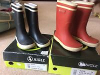 Aigle wellies£5 each pair size uk blue5 1/2 and red 7 childs wellies good condition