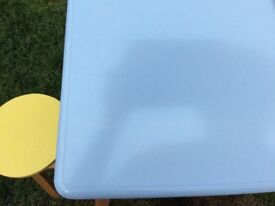 Retro Formica top breakfast table and two sunshine yellow stools