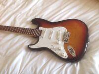 Vintage left handed stratocaster guitar sunburst
