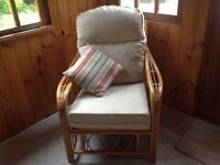 Two seater wicker sofa and two matching chairs