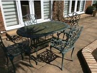 Metal Ornate Garden Table and 4 Chairs. Structurally in good condition but needs a coat of paint.