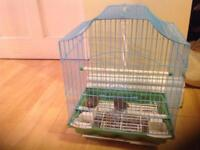 2 birds with a new cage