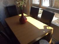 Solid wood six seater dining table extends to eight seats only selling due to downsizing ( no room)