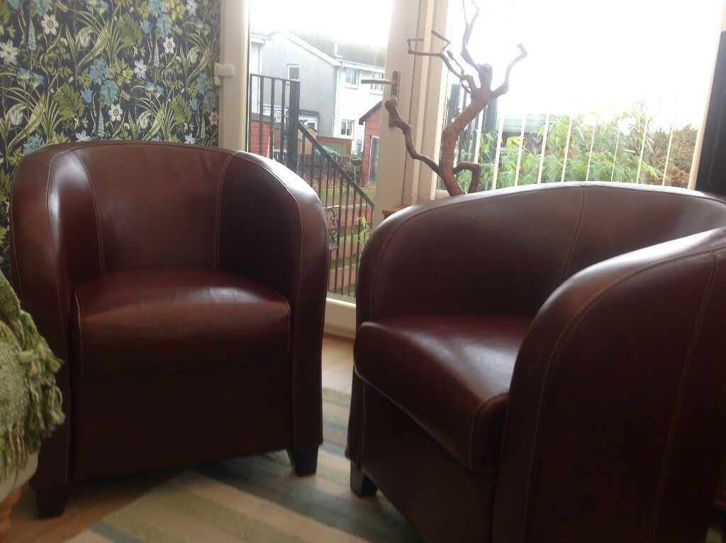 Two Deep Red Leather Tub Chairs