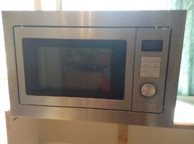 Integrated Stainless Steel Microwave 25lts. 900watts . L595xW410xH388mm . In excellent condition.