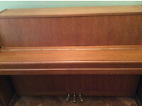 Japanese Yamaha M5 upright acoustic piano.