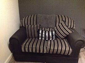 Two seater sofa. Excellent condition. Smoke free, pet free home. Collection only.