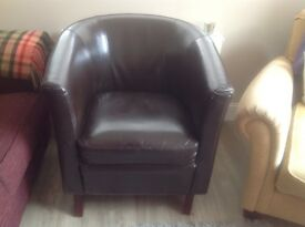 Brown tub chair in good condition