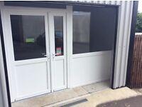 White pvc double door and glass panel extension(business,shop,door,building,garage)