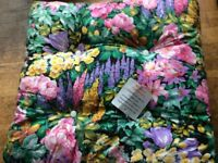 Brand new set of floral padded garden chair cushions