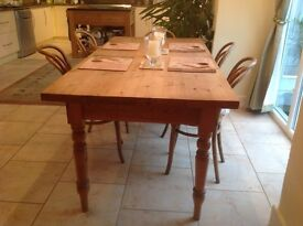 Large solid wood dining table and 5 wooden chairs