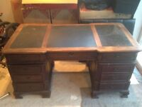 Here I have an dark wood leather top desk