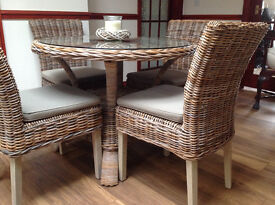 Cane Glass Topped Table complete with Four Matching Chairs and Cushions