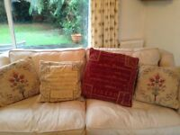 Leather 4 seater Cream Sofa, Fire resistant Hardly used.