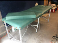 Portable treatment couch / massage table with metal legs, face hole and extension.
