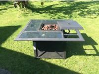 Outside table with gas powered coals.