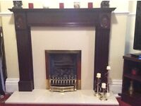 Gas fire with stone hearth and wood surround