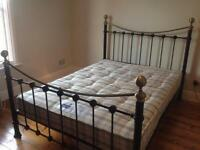 Standard UK double bed and mattress.