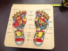 Reflexology foot board for highlighting points of the body.
