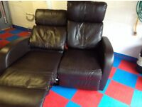 Two seater leather look recliner