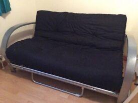 Futon style sofa bed..silver finish.