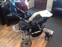 Black pram combination complete with attachable car seat,carry cot&pushchair.used but good condition