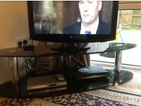 TV stand black glass.