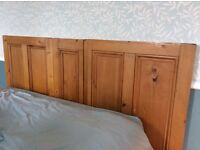 Stripped antique pine king size bed head which has been made out of old doors.
