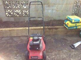 Petrol lawnmower.