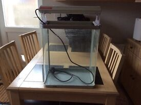 Fish tank for sale, good condition, silver coloured, over head light