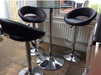 Dwell bar table with 3 brown bar stools