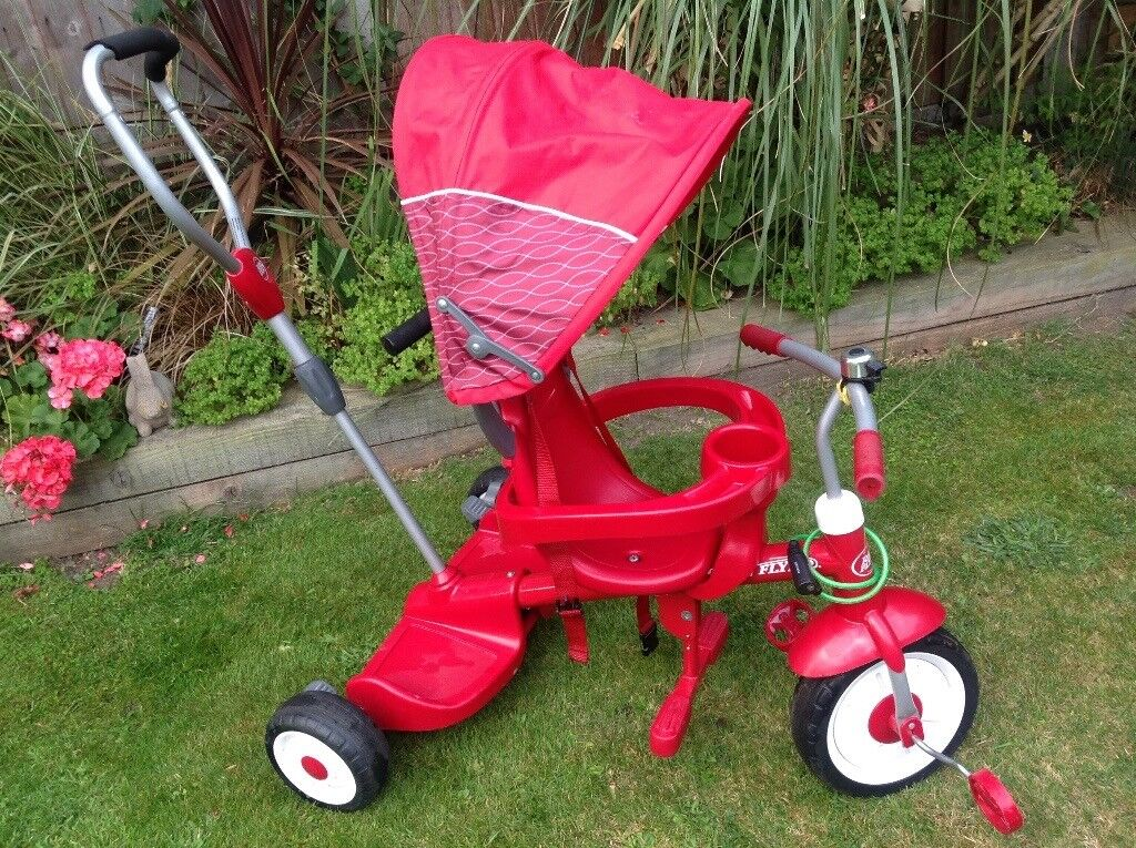 RADIO FLYER, red stand & ride trike / bicycle, 4 in 1 includes harness, canopy, steer, safety tray