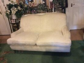 Lovely, stylish sofa. 2/3 seater. In good condition. Creamy white. Wooden legs.