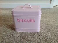 Pink metal biscuit tin