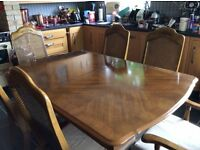 Extending dining room table and six chairs bought originally from maskreys Cardiff .