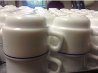 250 White China Cups and Saucers with Royal Blue Rim.