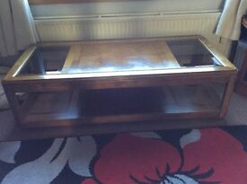 Beautiful Coffee table solid wood 2 glass panels on each side on the top