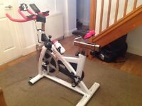 Active woman spin cycle exercise bike.