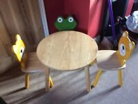 Solid wood, children's play table and chairs by Pintoy