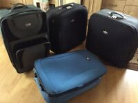 FOUR LARGE SUITCASES