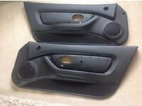 MG TF AND MGF PAIR OF BLACK DOOR CARDS . WITH TOP WINDOW SEALS.