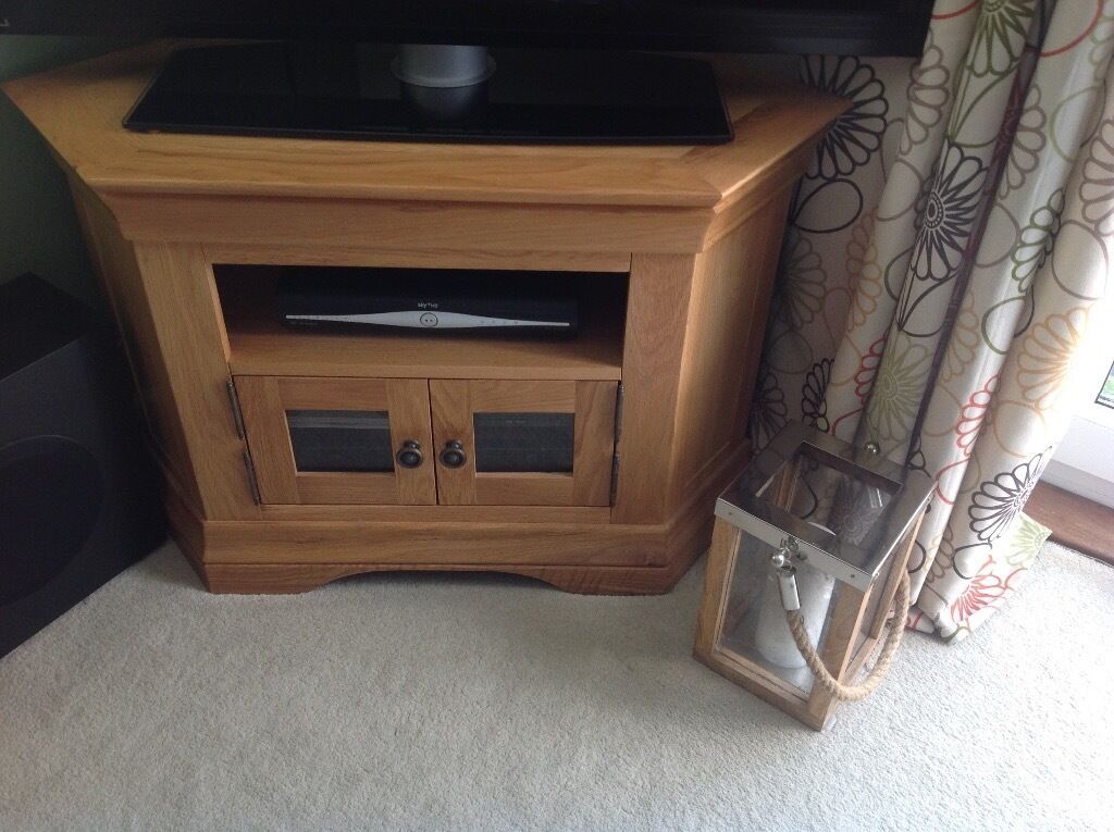 Bookcases and TV corner cabinet for salein South East London, LondonGumtree - Solid oak furniture no marks or scratches as good as new. Corner TV cabinet H 63cm, W 95cm, D 50cm to corner. £125 Tall bookcase/CD storage H 4ft, W 38cm, D 22cm. £125 Bookcases/DVD storage H 88cm, W 90cm, D 30cm £125 If all 3 purchased together...